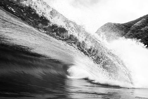 Black and white of foamy ocean big wave with splashing water in tropical country in stormy weather in summer outside