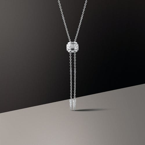 Silver Necklace on White Table