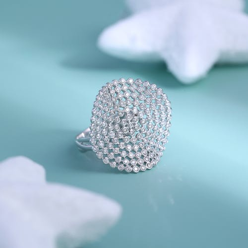 Silver Diamond Studded Ring on Green Surface
