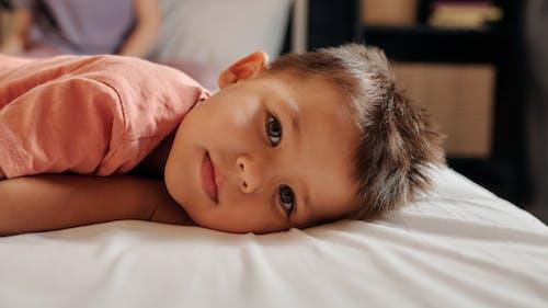 Close-Up Photo of a Cute Kid Looking at the Camera