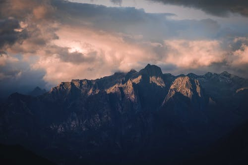 Dramatic sky and mountains at sundown