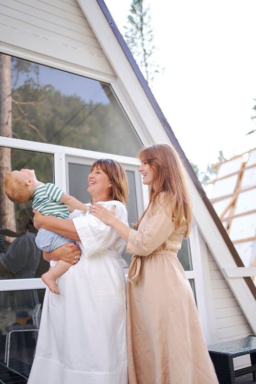 Glad women spending time with child