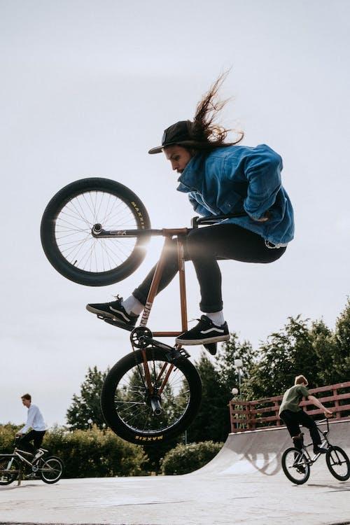 Woman in Blue Jacket Riding on White Bmx Bike