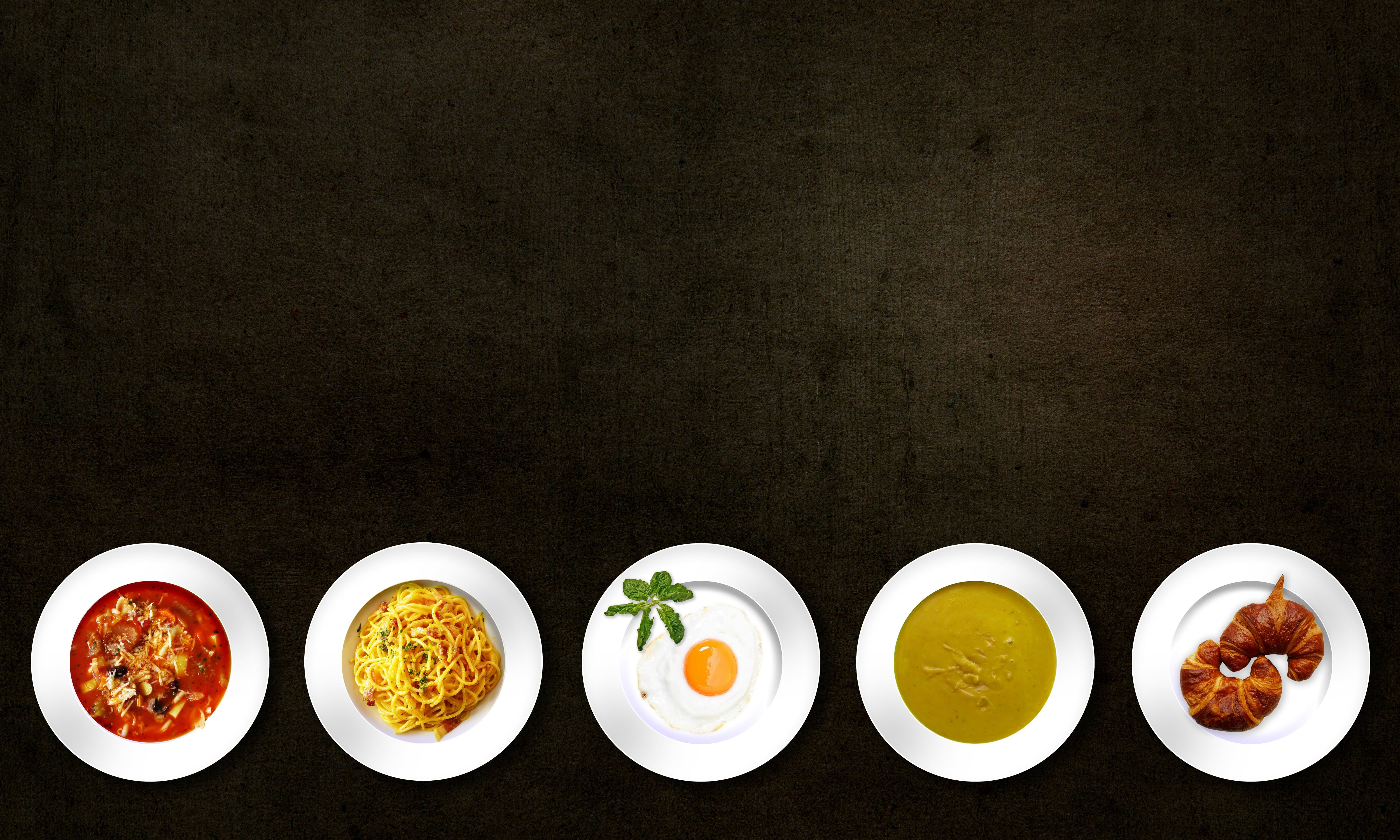 Five plates of different food