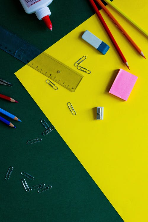 Pink Sticky Notes on Yellow Table