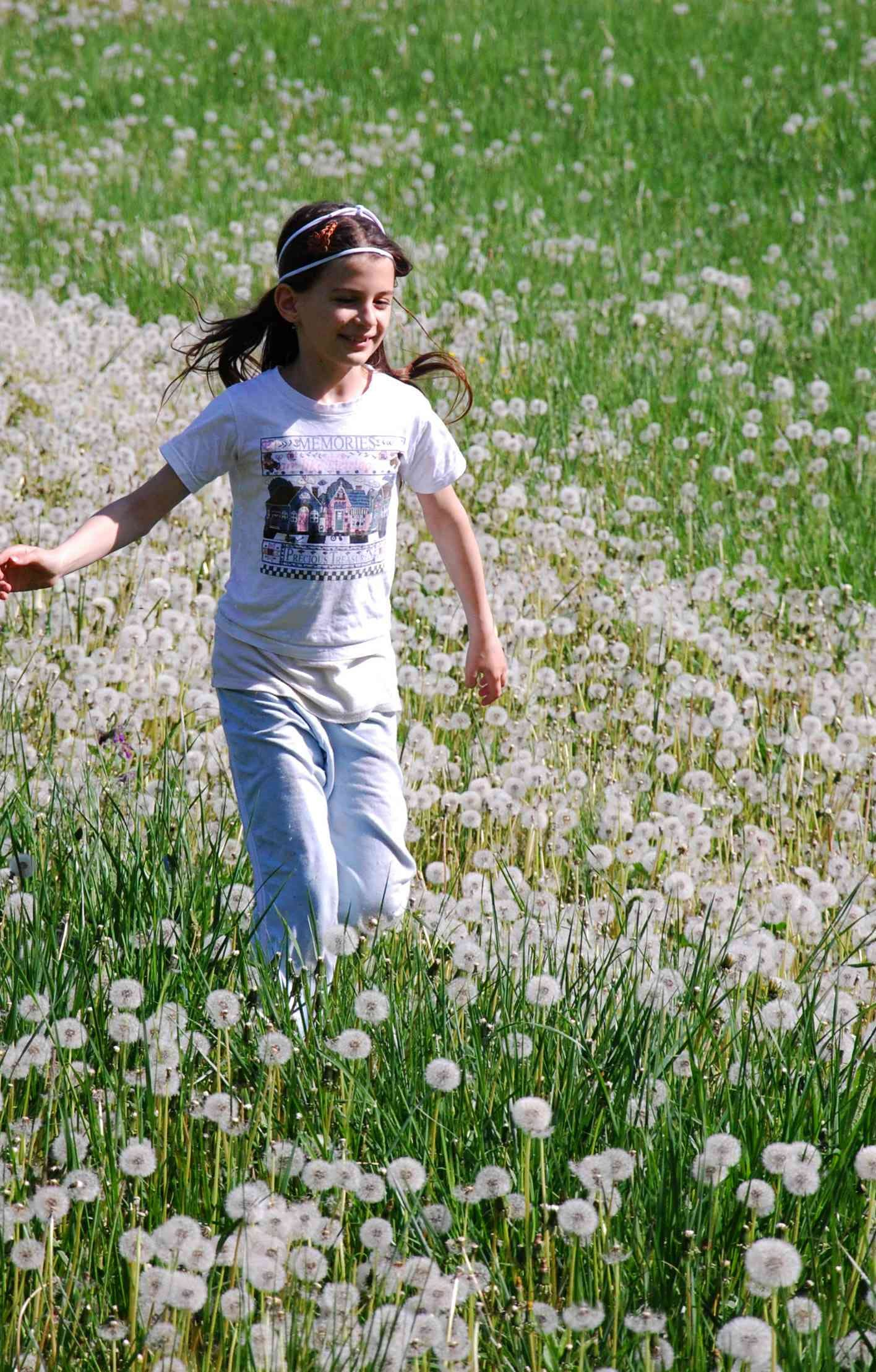 Girl Standing on White Petaled Flowers