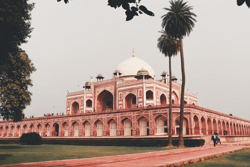 Facade of famous medieval building named Humayun Tomb located in Delhi in India in summer day under cloudless gray sky