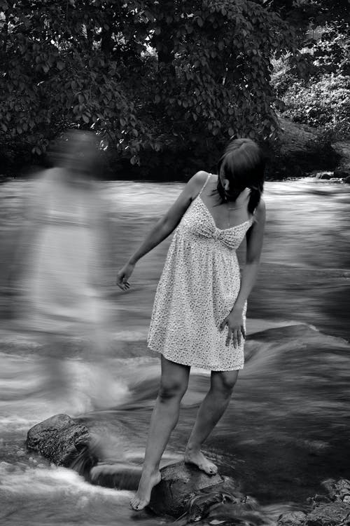 Woman standing near river in nature