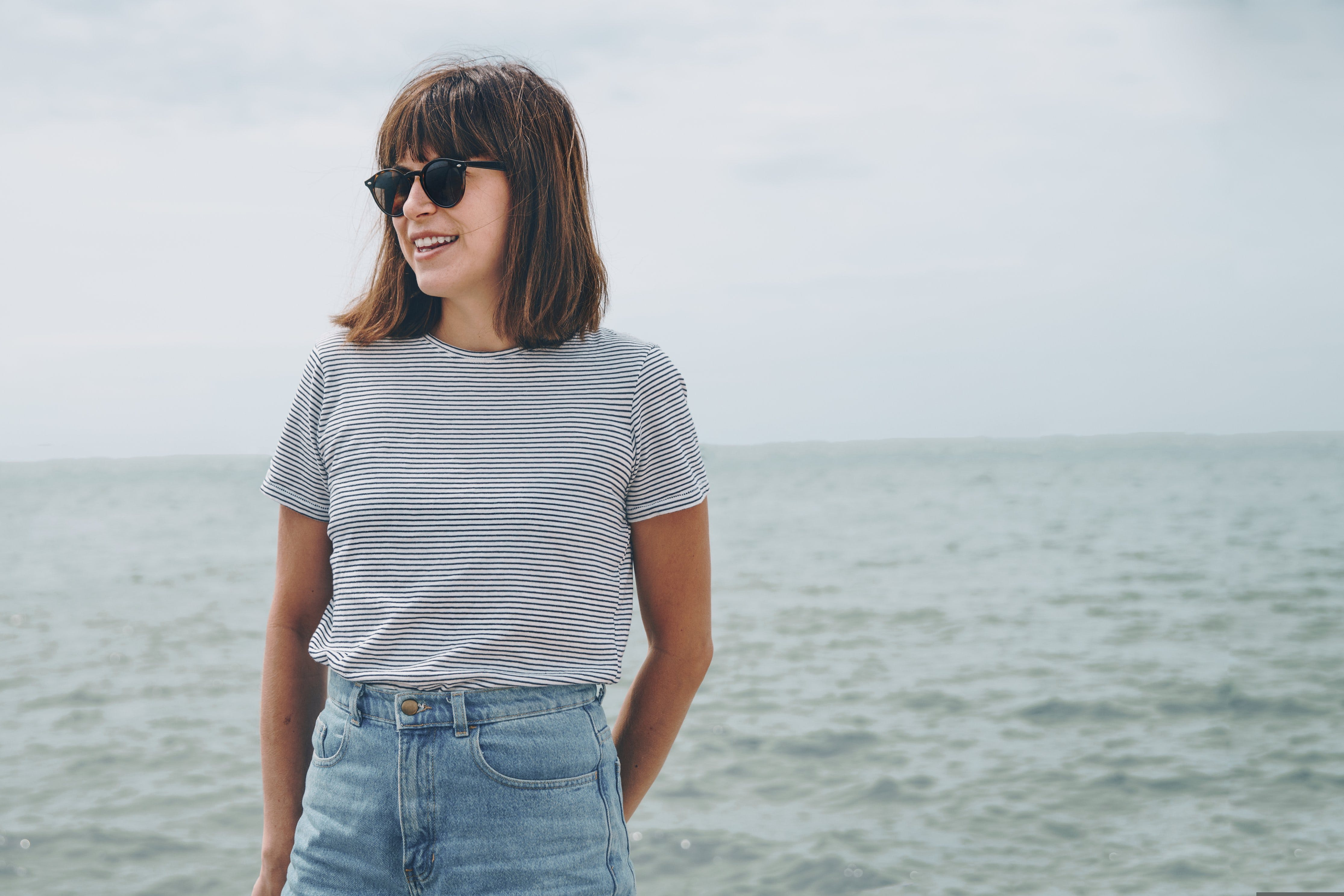 Woman Standing Near Sea While Wearing Black Frame Sunglasses