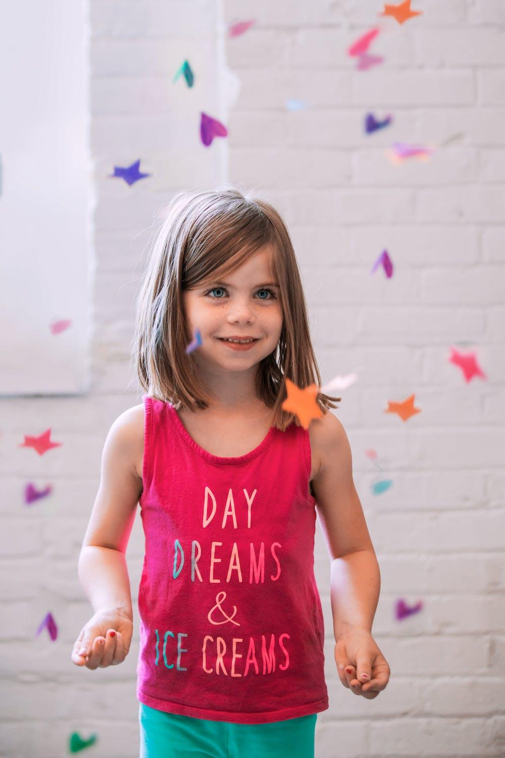 Little girl smiling.   Photo: Pexels