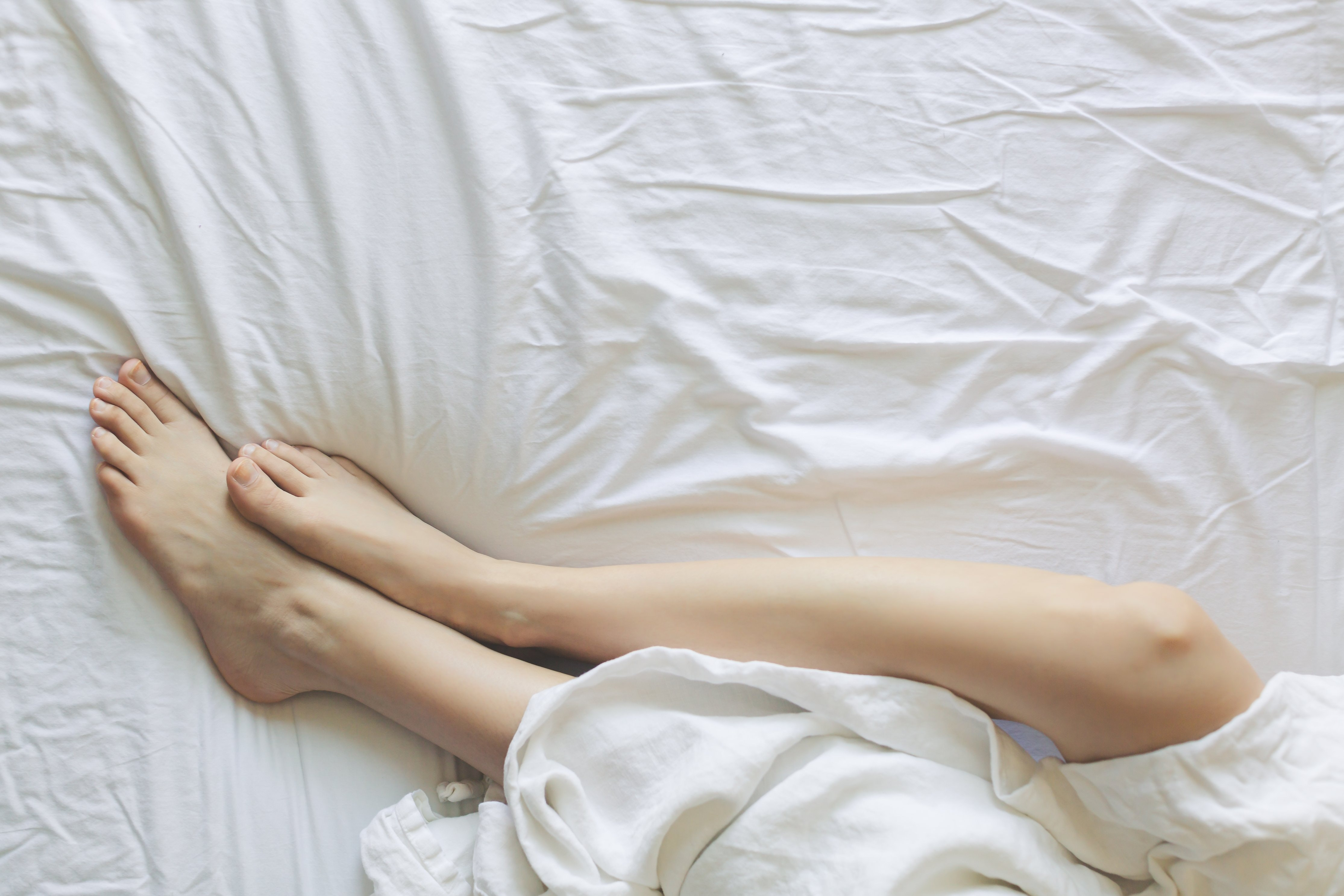 Image result for legs in bed