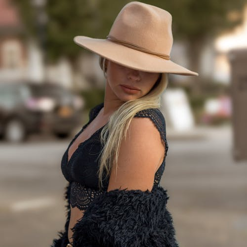 Anonymous woman in hat on street