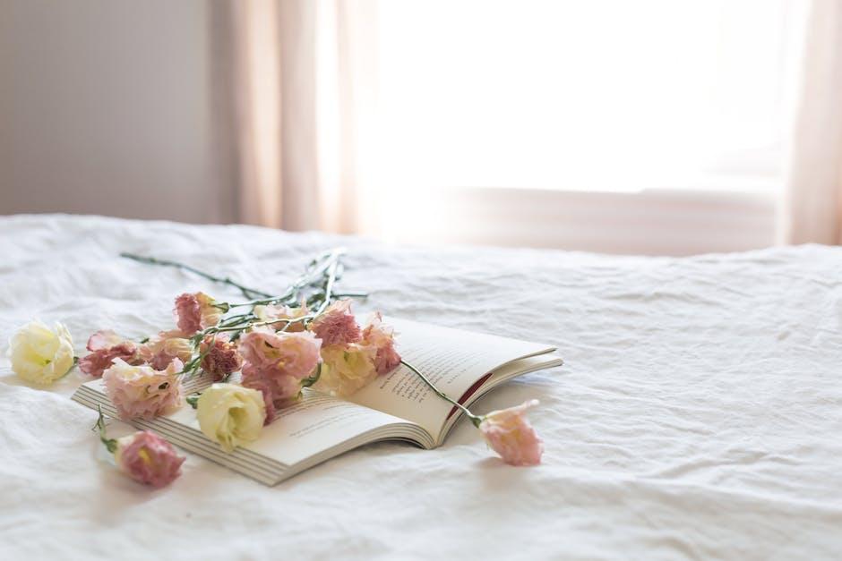 Flowers on book near window
