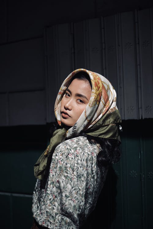 Calm Asian woman in headscarf