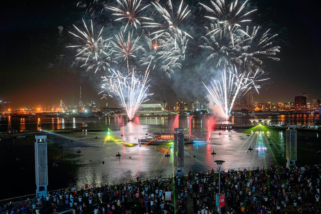 People Watching Fireworks Display at Night