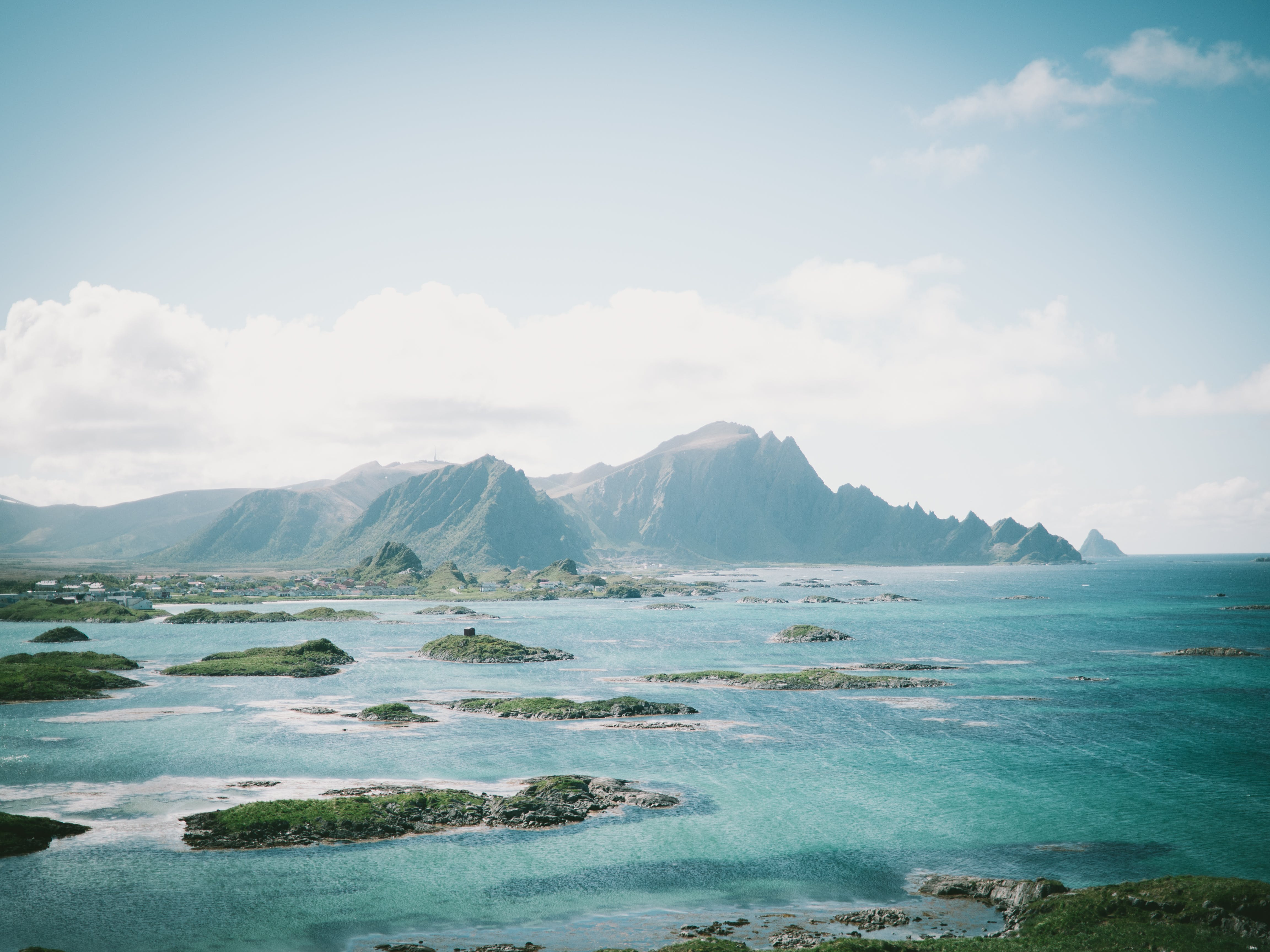 Green Grass-covered Islands during Day