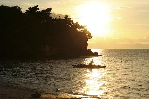 Free stock photo of sea, sunset, beach, fisherman