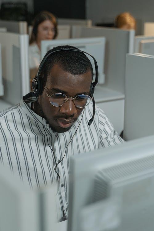 Man in Black Framed Eyeglasses and White and Black Striped Dress Shirt