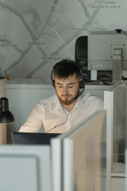 Man in White Dress Shirt Sitting in Front of Computer