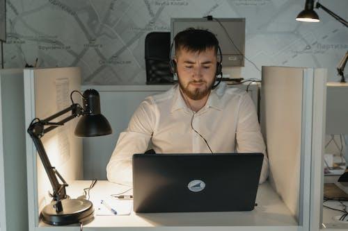Man in White Dress Shirt Using Macbook