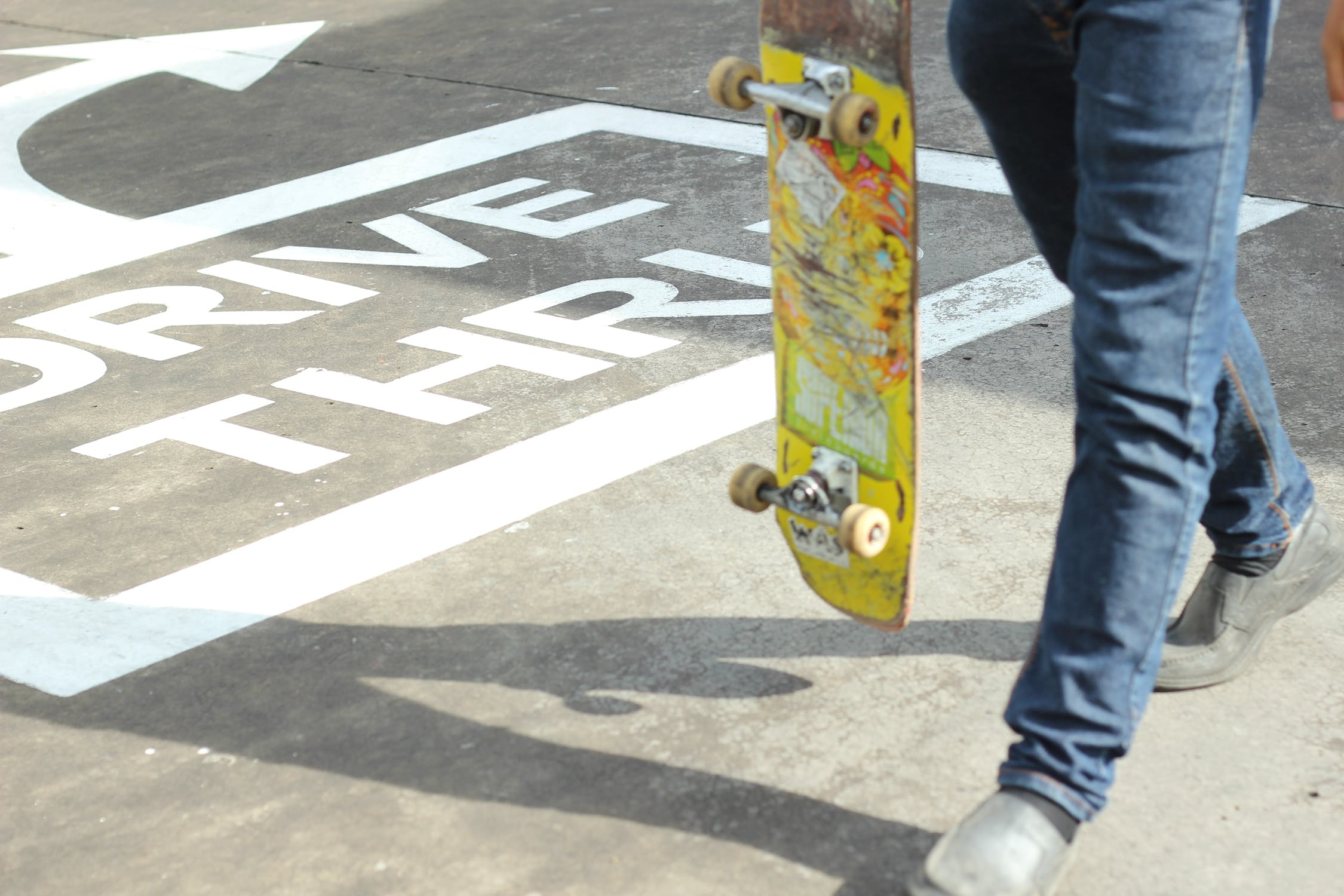 Person Holding Yellow Skateboard