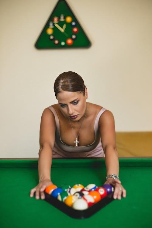 Woman in Brown Tank Top Playing Billiard