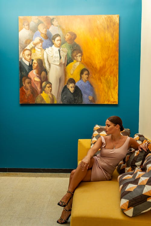 Woman in White Shirt Sitting on Couch