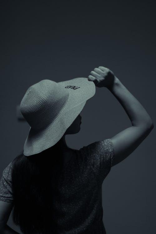 Woman in straw hat in studio