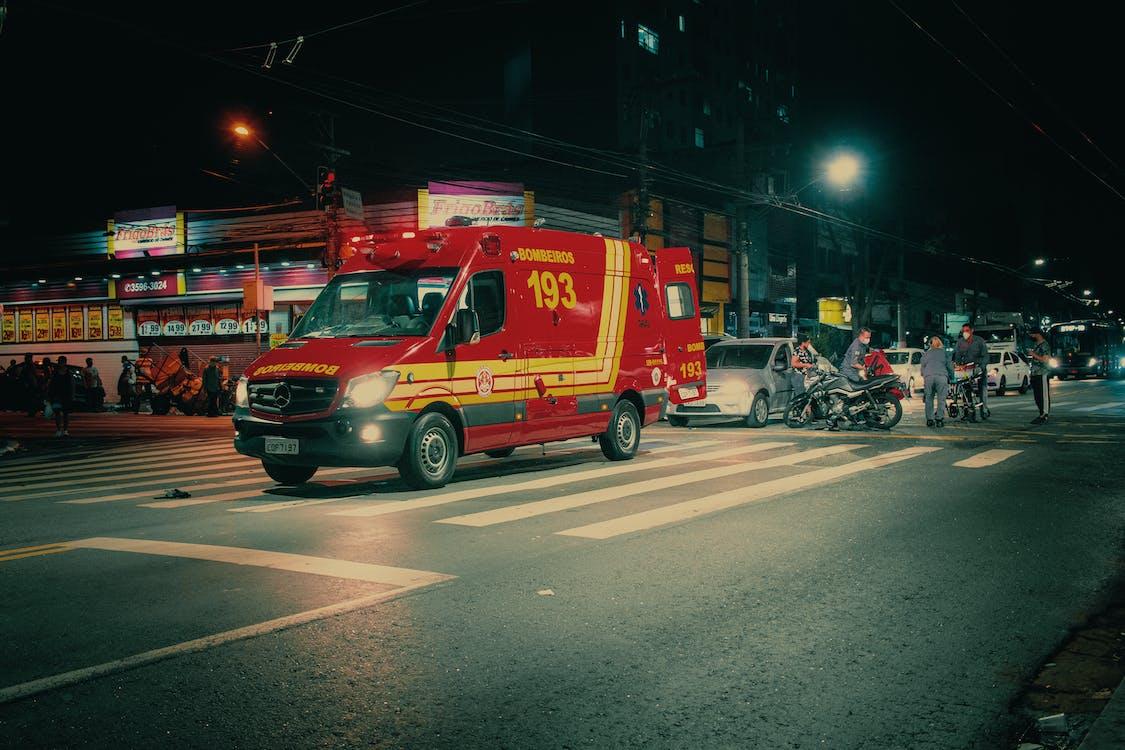 Ambulance car on city road at night