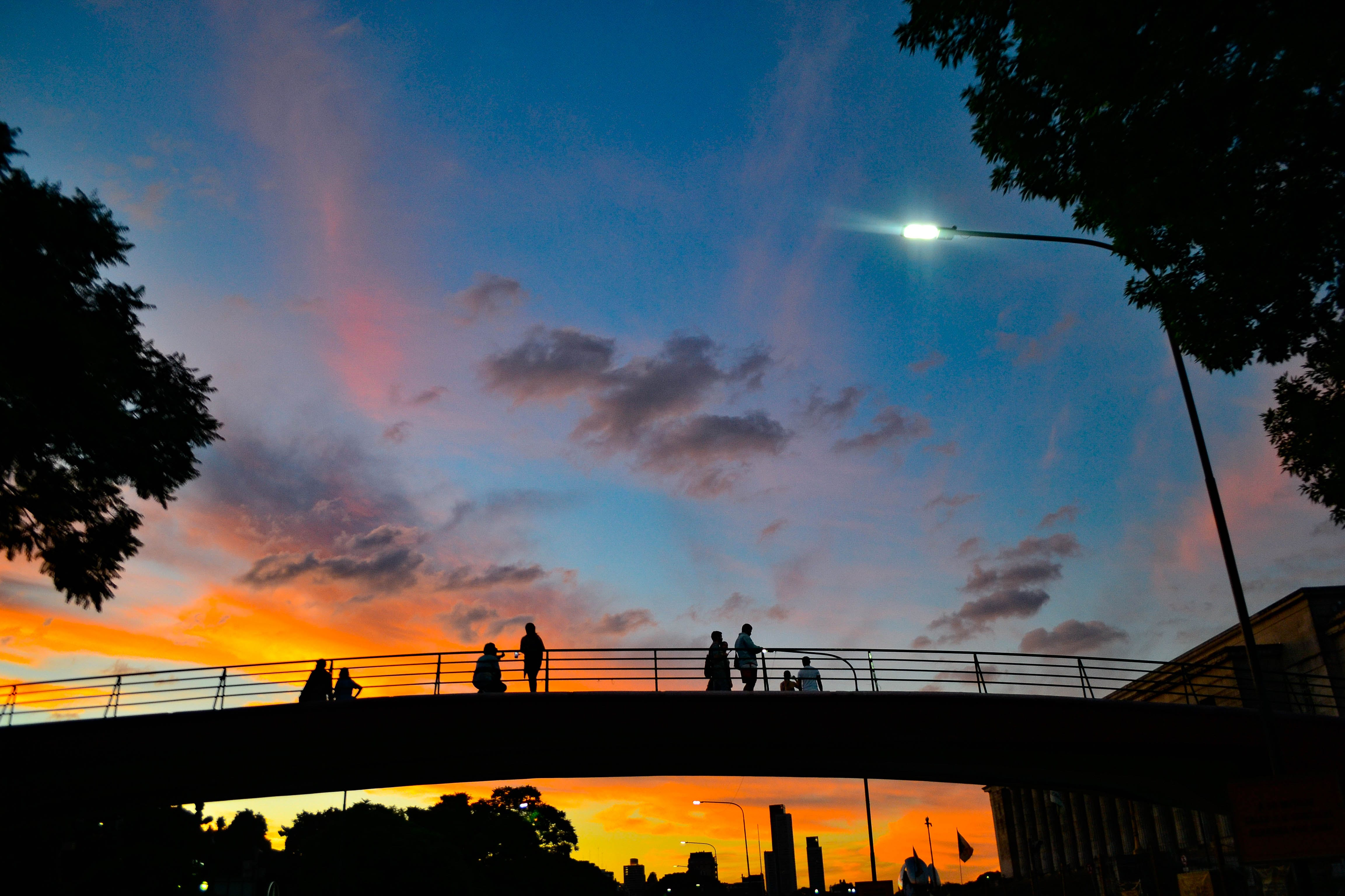 Silhouette Photography of People Standing on Bridge