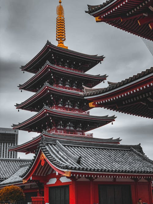 Red and Black Pagoda Temple Under White Clouds
