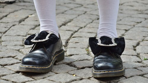 Person in Black Leather Shoes