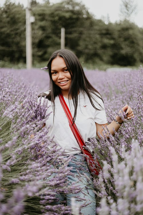 Smiling woman in aromatic lavender field