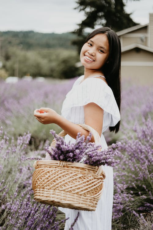 Charming woman with basket of flowers