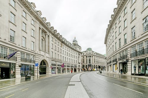 Photo of an Empty Road Between Old Buildings