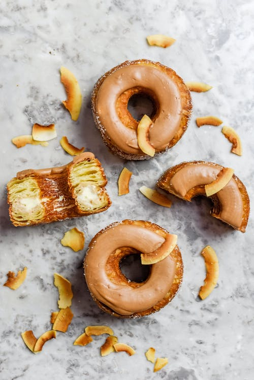 Brown Doughnuts on Marble Surface