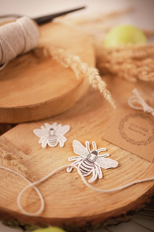 Threads and applique work ornaments on wooden board