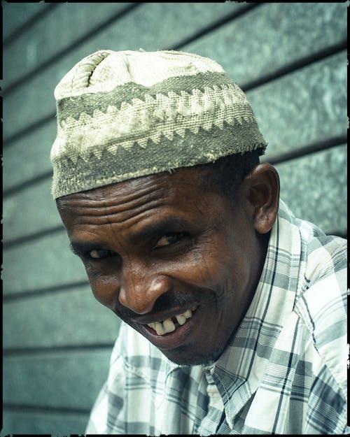 Cheerful senior black man with bad teeth smiling at camera