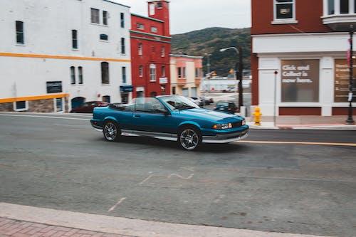 Blue cabriolet on asphalt road