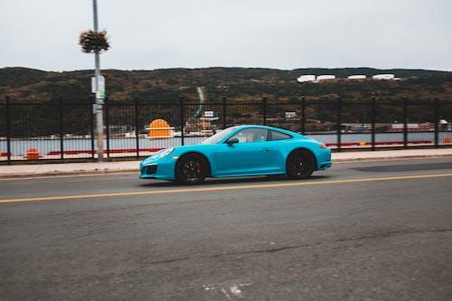 Modern car riding along quay