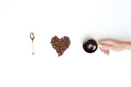 Gratis lagerfoto af bønner, drink, hånd, kaffe
