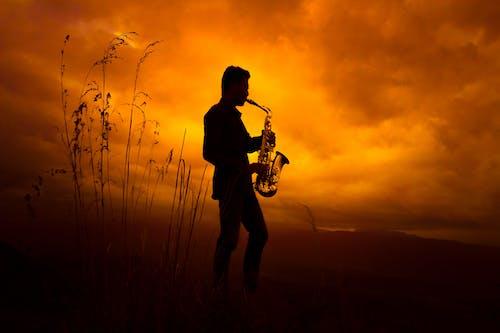Kostenloses Stock Foto zu saxophon, sonnenuntergang