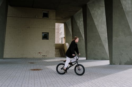 A Woman Riding on a Bicycle