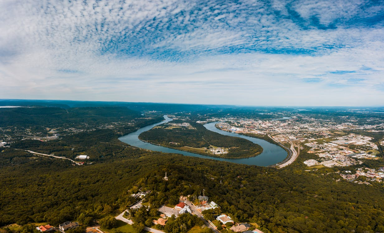 Breathtaking scenery of Tennessee River flowing near Moccasin Bend Archaeological District against cloudy blue sky