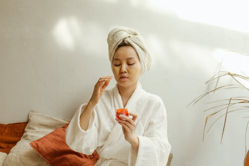 A Woman Holding a Skin Care Product