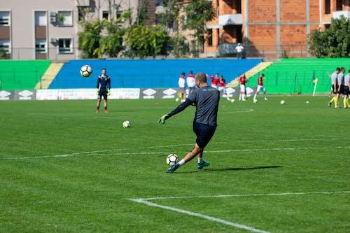 Man Practicing Soccer
