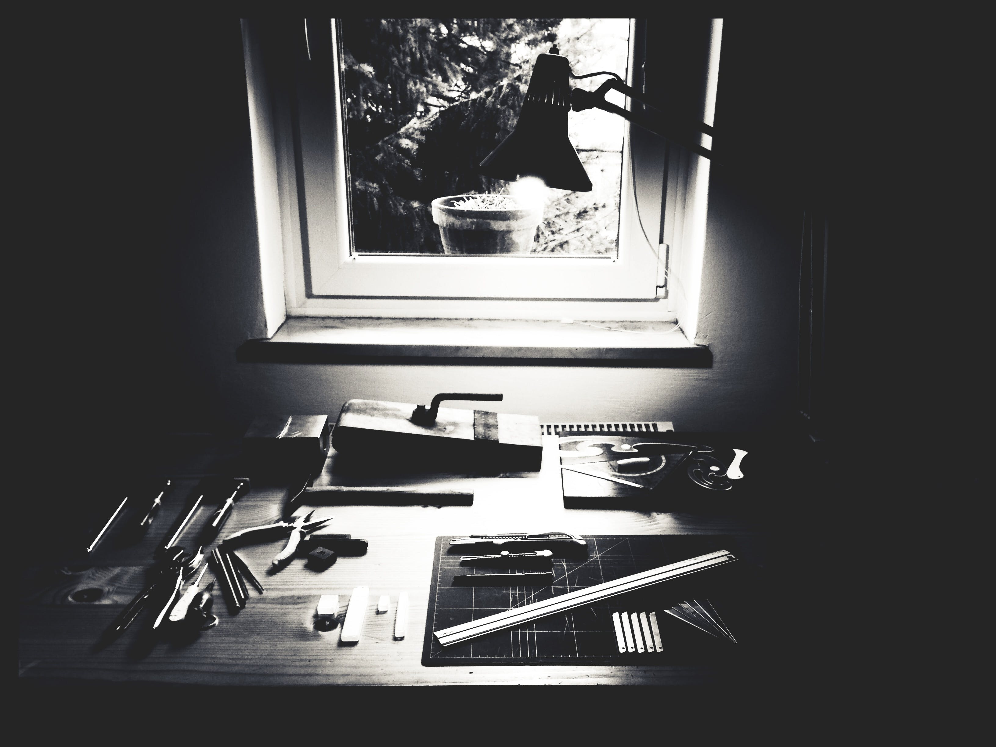 Tools on Table Grayscale Photography