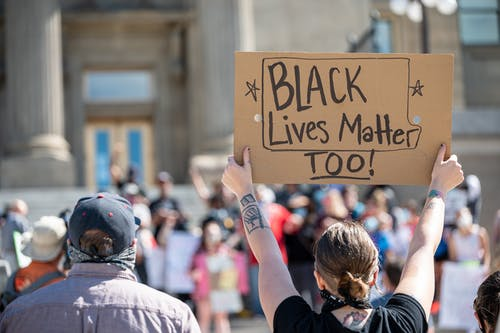 People on demonstration with posters for saving black lives