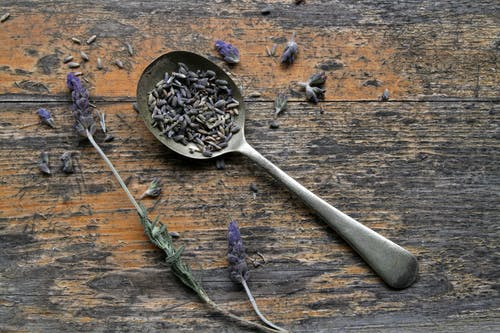 Stainless Steel Spoon on Brown Wooden Table
