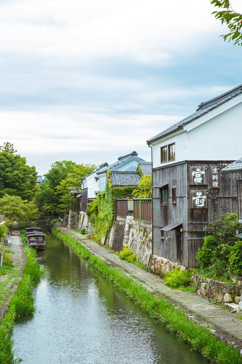 Picturesque scenery of narrow Hachiman Bori canal flowing between aged traditional houses in Omihachiman city